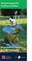 """Das Titelbild des Flyers über die Kunstwerke im Skulpturengarten im Außenbereich des Schafhofs - Europäisches Künstlerhaus Oberbayern zeigt die Skluptur """"SpaceSheep"""" des ungarischen Künstlers Csongor Szigeti, ein silbernes, halb abstraktes Schaf auf einer Wiese."""